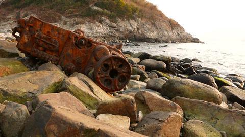 The wreckage on rocky coast: rusty ship engine skeleton Stock Video Footage