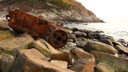 The wreckage on rocky coast: rusty ship engine skeleton Footage