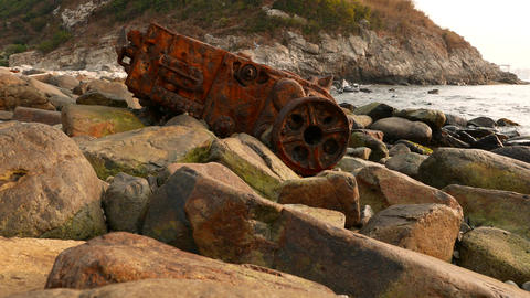 Rusty skeleton of ship engine on the rocky coast Stock Video Footage