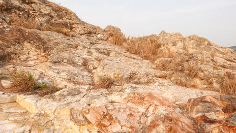 Close view to rocky cliff, climb up a little and look... Stock Video Footage