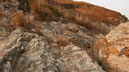 Close View To Rocky Cliff, Climb Up A Little And Look Around On Bay And Island stock footage