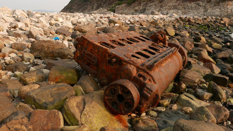 Ship engine rusted skeleton on rocky shore, close up Stock Video Footage