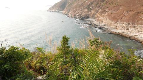 Climb down trodden footpath on green island hillside, POV... Stock Video Footage