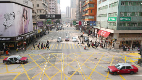 Street intersection traffic, people and vehicle move on green light. Top view Footage