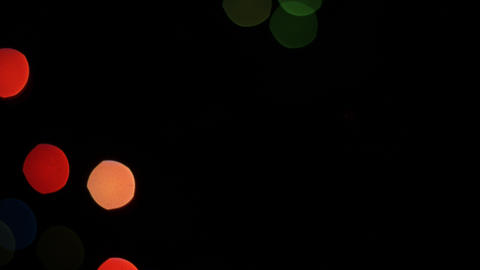 Colorful lights bokeh on black background. Static Stock Video Footage