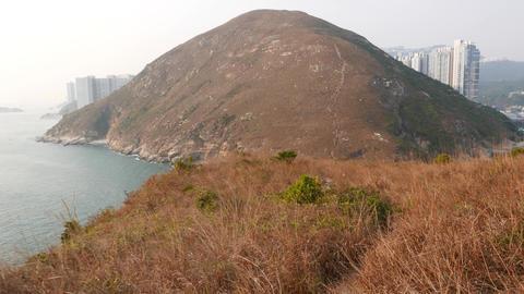 Mountain island landscape POV walk forward along trodden path Footage