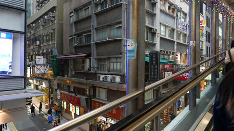HongKong Street from the moving escalator. Building corner Stock Video Footage