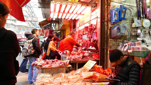 Dexterous chinese butcher in outdoor fresh meat shop,... Stock Video Footage