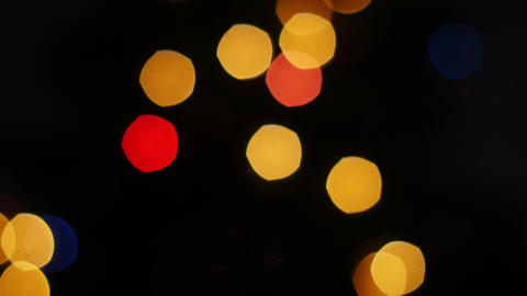 Colorful lights bokeh on black background. Pan Stock Video Footage