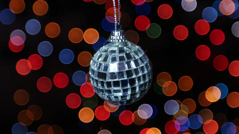 Mirror ball at background of blurred lights. Bokeh Stock Video Footage