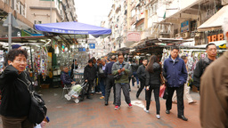 Chinese man speaking on phone on crowded street Footage