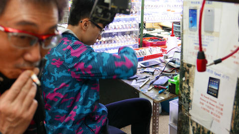 Young boy disassemble smartphone, street market repair... Stock Video Footage