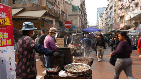 Roasted quail eggs in wok on street market, from general to close up view Footage