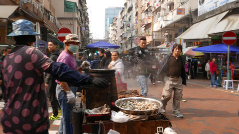 Roasted quail eggs in wok on street market, from general... Stock Video Footage