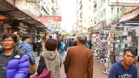 Old faces on the busy trading street of HongKong Stock Video Footage