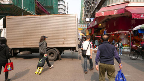 Typical busy street in distant district of HongKong city Stock Video Footage
