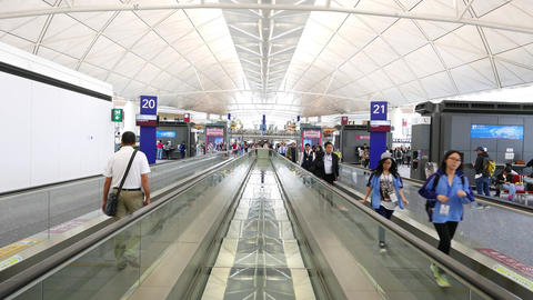 Passengers use moving walkway at international airport,... Stock Video Footage