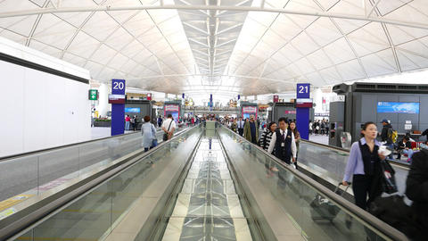 Passengers use moving walkway at international airport, travel towards and away Footage