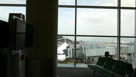 Cebu Pacific Airline plane park at apron, seen through... Stock Video Footage
