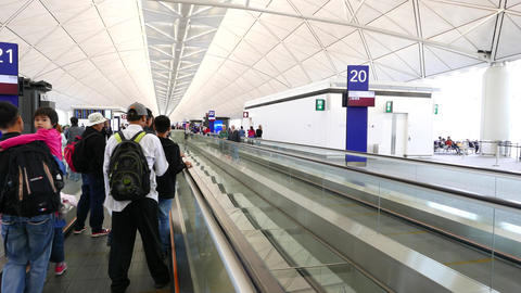 Moving walkway at modern airport, POV travel to departure... Stock Video Footage
