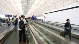 Moving walkway at modern airport, POV travel to departure gate, passengers Footage
