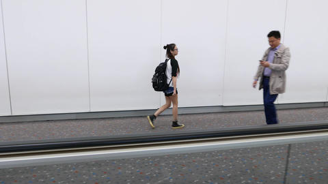 Young asian girl walk alone at airport, people passing,... Stock Video Footage