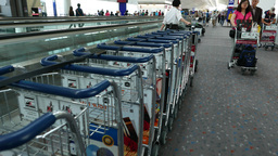 Airport personnel, woman tow stacked luggage trolley,... Stock Video Footage