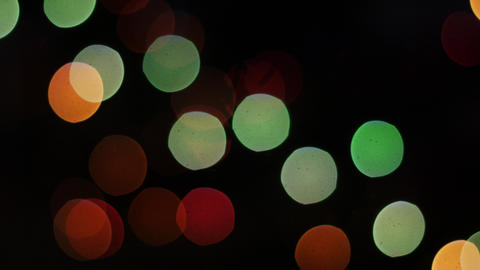 Colorful lights bokeh on black background. Static Footage