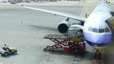 Luggage container lift up and loading into aircraft,... Stock Video Footage