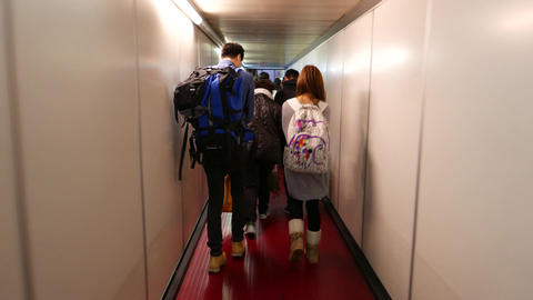 Young Travellers Couple Walk Out Plane By Jet Bridge, Follow Camera stock footage