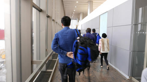Passengers Walk To Transfer Through Airport Passage, First Person View stock footage