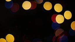 Colorful lights bokeh on black background. Loop Stock Video Footage