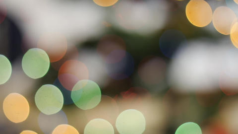 Colorful bokeh of Christmas lights tree. Pan Footage
