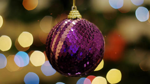 Christmas purple ball shakes at background bokeh Footage