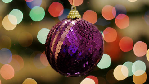 Christmas purple ball shakes at background bokeh Stock Video Footage
