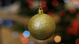 Christmas golden ball rotates at background bokeh Footage