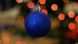 Christmas blue ball shakes at background bokeh Footage