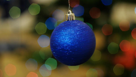 Christmas blue ball rotates at background bokeh Stock Video Footage