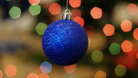Christmas blue ball rotates at background bokeh Footage