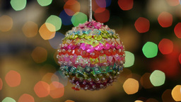 Colorful ball rotates at background bokeh Footage