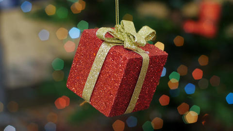 Christmas gift toy shakes at background bokeh Stock Video Footage