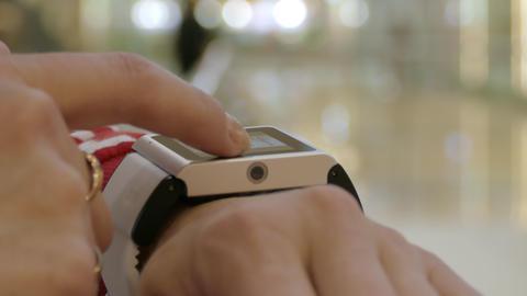 Woman Using Her Smart Watch , Indoor Stock Video Footage