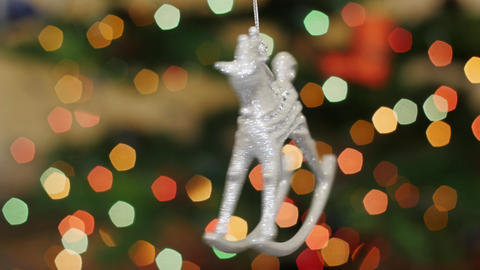 Christmas horse toy rotates at background bokeh Footage