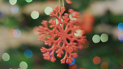 Christmas snow toy rotates at background bokeh Stock Video Footage