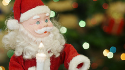 Toy Santa Claus moves at background bokeh lights Stock Video Footage