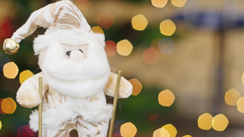 Santa Claus on skis at bokeh lights. Title area Stock Video Footage