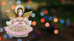 Christmas angel doll at bokeh lights. Title area Footage