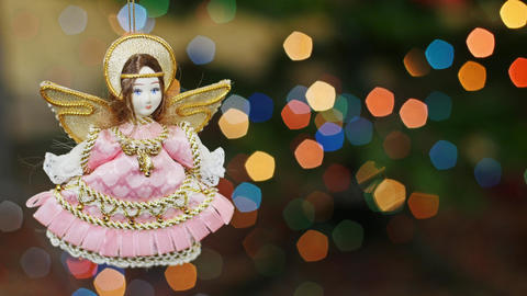 Christmas angel doll at bokeh lights. Title area Stock Video Footage