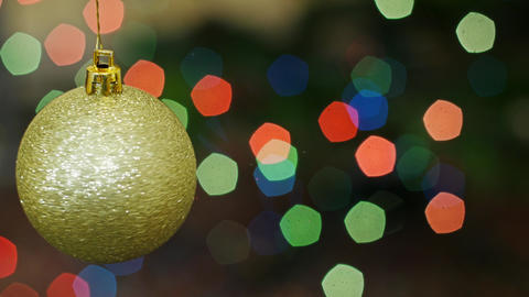 Christmas golden ball rotates at bokeh. Title area Stock Video Footage
