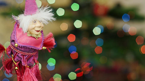 Christmas witch toy shakes at bokeh. Title area Stock Video Footage